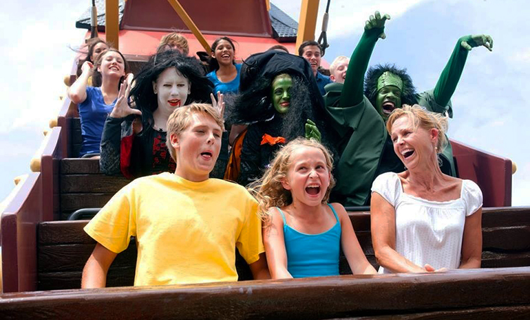 People riding the Prairie Schooner at Frontier City