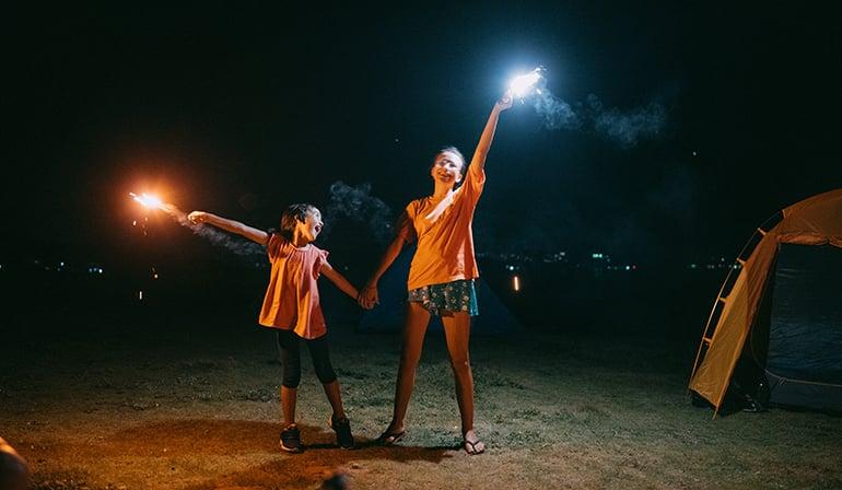 2 children holding sparklers