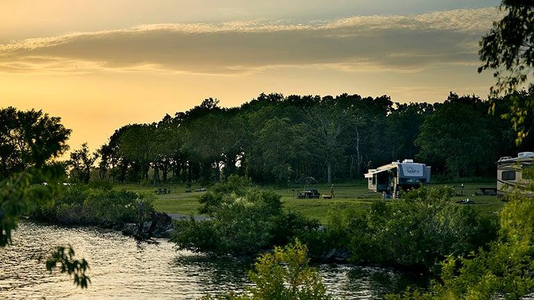 Two RVs at campsite next to Lake Texoma