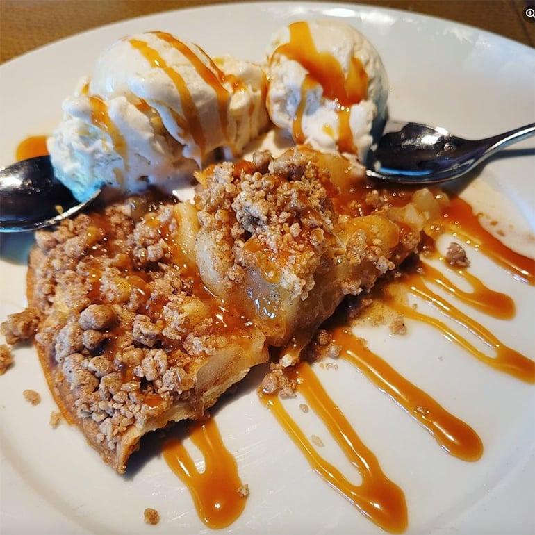 FLINT's Dutch Apple Pie with vanilla ice cream on plate.